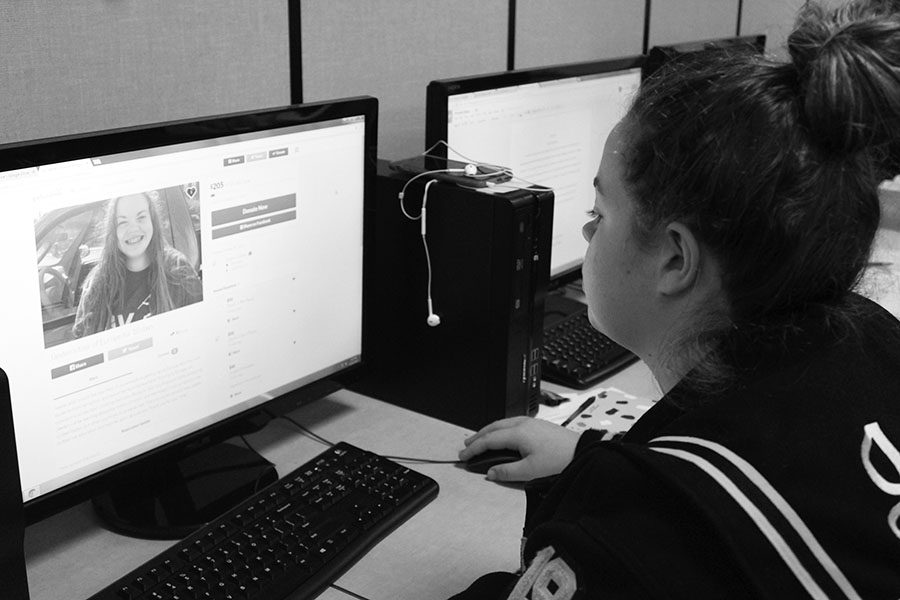 "Sophomore Jaeden Cochran navigates her 'GoFundMe' page.  Cochran has raised $205 of her $5,000 goal. Cochran is not only excited about the money that she has raised so far, but about her experinces in Europe, ""I'm looking forward to all the different culture I'll get to see and I'm excited to get to try all the different food,"" Cochran said."