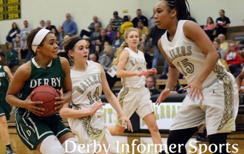 Kernal defends Derby's Aliyah Myers during the home game Jan. 10. Newton won 41-32.