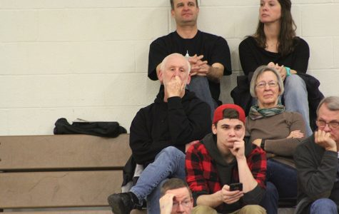 "Norm Lichte analyzes home railer boys basketball game. ""[I still go because of] the enjoyment I get from it. I'm having fun,"" Lichte said."