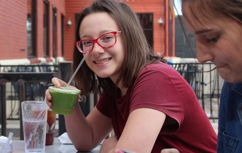 Freshman Ellen Garrett smiles with enjoying her juice at the Lotus Leaf Cafe on Feb. 23. The restuarant's menu offered diverse food and drink options for vegetarians and non-vegetarians.