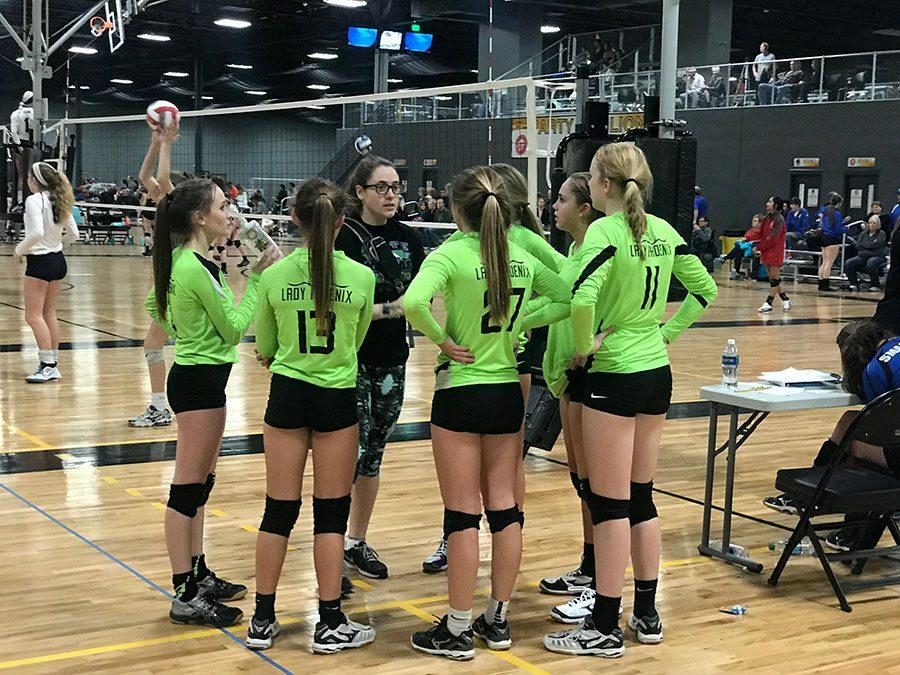 Senior Megan Akers instructs her 16 and under team at the Wichita Sports Forum on Sunday Feb. 12. She reflected on her nine years of club in order to coach tournaments.
