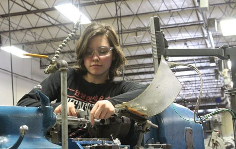 Sophomore Alexandra Murray works with wire in Area 9 at the machining shop.
