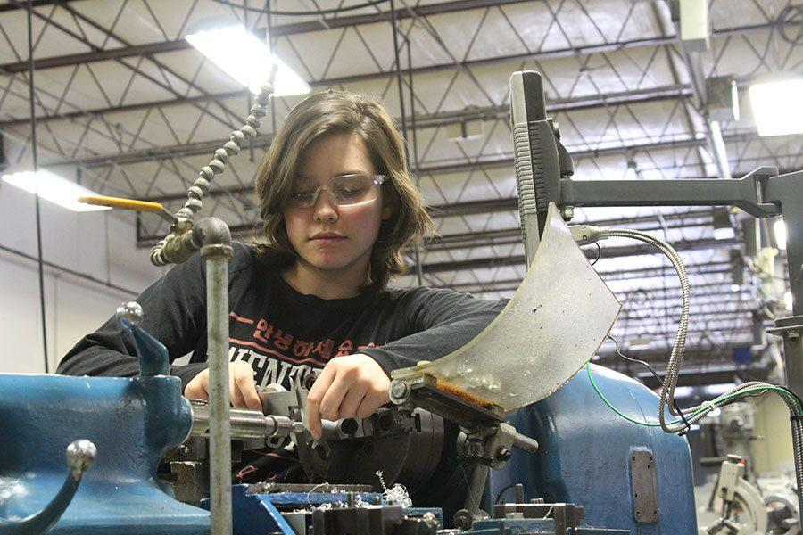 Sophomore+Alexandra+Murray+works+with+wire+in+Area+9+at+the+machining+shop.
