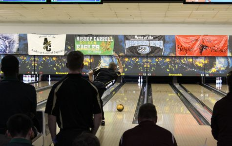 Senior Jake Lindenmeyer throws his ball down the lane to pick up the pins he left. Lindemeyer went on to spare this shot.