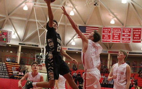 Freshman Ty Berry drives to the basket against a McPherson defender on Jan. 24. The final score was 63-65, McPherson.