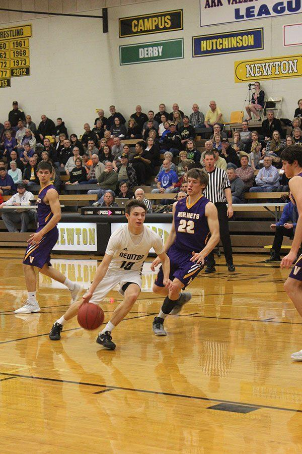 Junior Cailen Valdez dribbles to the basket during sub-state on Mar. 2.