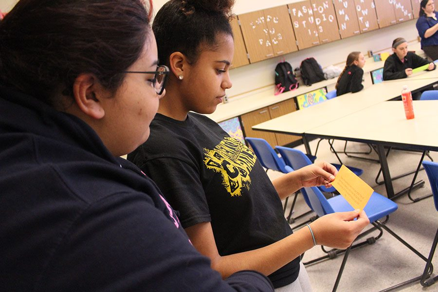 FCCLA club member juniors Acacia Petrie and Gabrielle Gallegos read a clue they were given for their scavenger hunt. The girls clue took them directly to the auditorium, then to find their next clue.