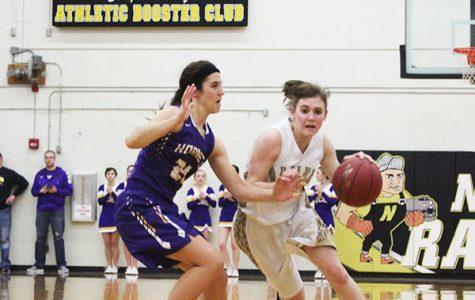 Junior Kyndal Bacon drives past a Valley Center defender.
