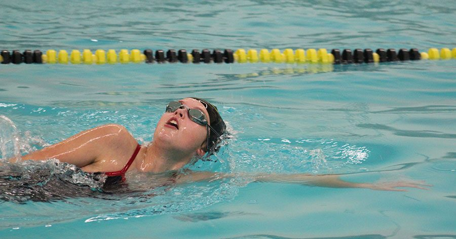 Cutting her way through the pool, freshman Emily Penner practices for her first week of swimming practice. Their first meet will be held at Wichita Heights high school on Friday March 31st.