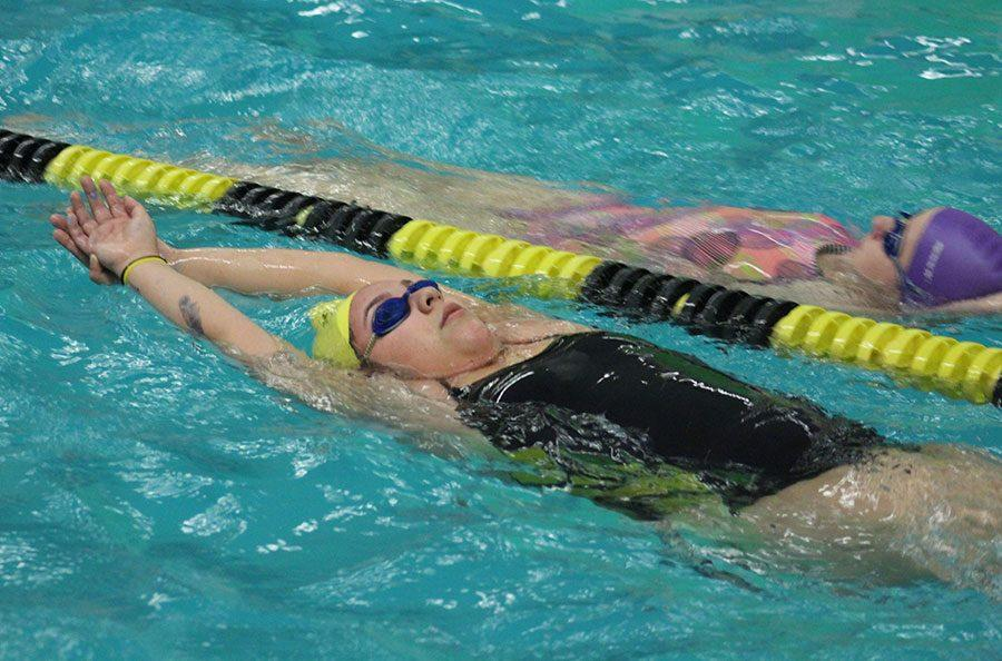 Senior Nadia Montelongo swims her way down the far lane of the pool. This is Montelongo's fourth year being on the swim team.