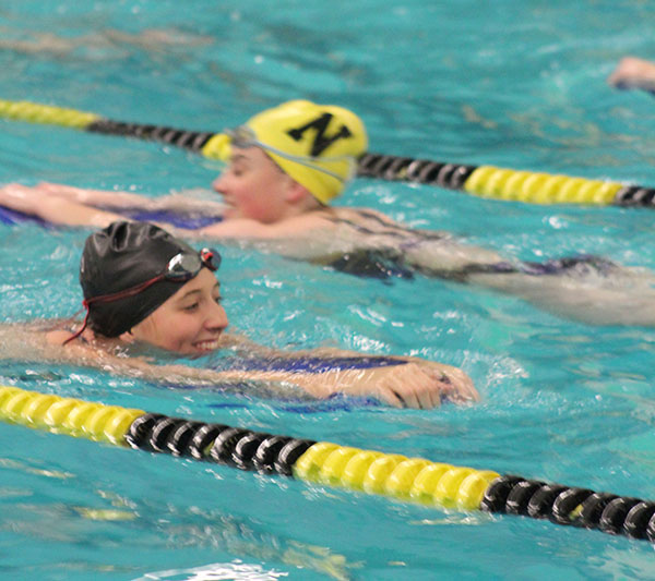 Senior Emily Robinson starts of her final season of swimming fluttering down her lane on a boogy board. This season, the team has about seven meets to prepare for not including AVCTL or state.