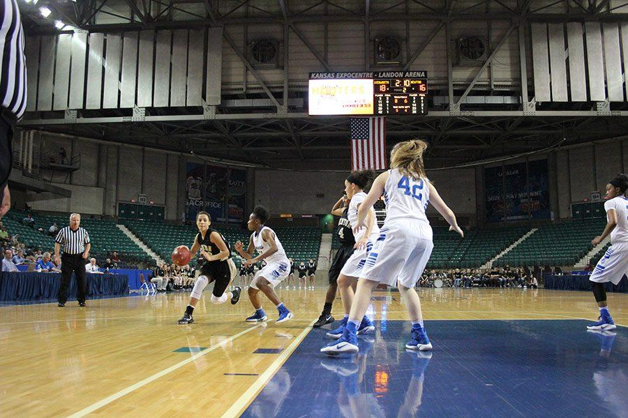 Junior+guard+Jada+Berry+drives+to+the+basket+against+the+Leavenworth+defense+during+the+first+round+of+state+basketball+on+Wednesday+March+8+at+the+Topeka+Expocenter.