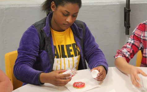 Junior Rosa Witterick decorates her cookie with sprinkles.