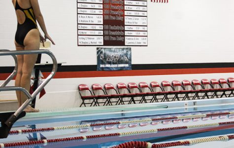 Preparing to dive, junior Naomi Kuhn counts her step in order to get her timing right.