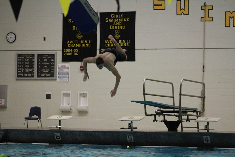 Flying through the air sophomore Wyatt Hendrickson attempts another dive. Hendrickson has been in Fitness Club two years.