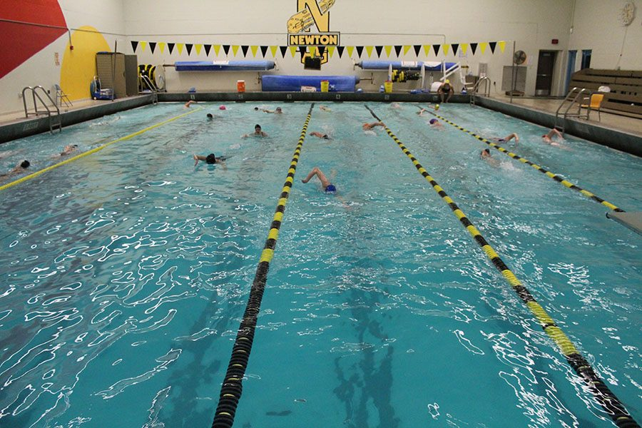 Striving+for+perfection%2C+the+girls+swim+team+practices+their+freestyle+swimming+by+swimming+up+and+down+the+lanes.+The+girls+are+coached+by+Kim+Powell.