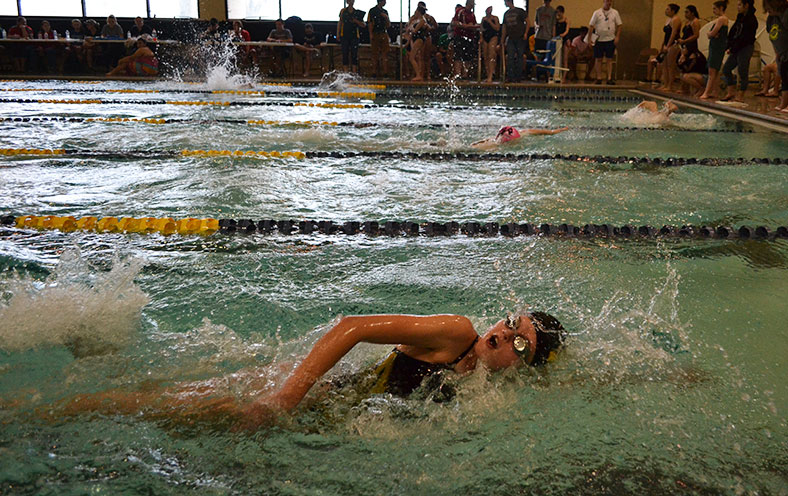 Freshmen Emily Penner competes in the 100 yard freestyle. Along with Penner, two other freshmen competed at the invitational.