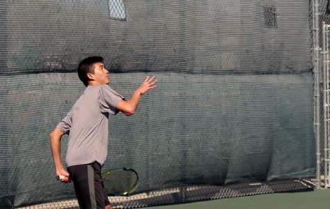 Junior Jason Wong prepares his serve to his opponents. The Railers took second at their first home invitational.