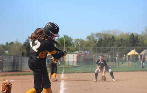 Keeping her eye on the ball, senior Dawsyn Long swings for a hit.