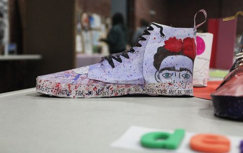 Students from drawing and painting II showcase their personalized converse at the Art Show.