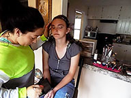 Taking out time senior Emily Terbovich carefully sits still while her aunt Danielle Pierce does her makeup for prom. Terbovich didnt have a specific makeup look she wanted for prom.