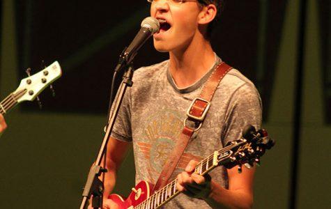 Belting out the lyrics, sophomore Seth Bontrager sings the original song Danger No Diving performed called Lesbian.