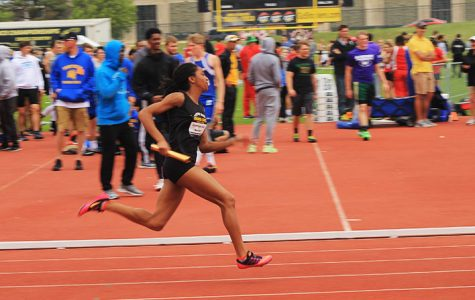 Sophomore Kalli Anderson runs the first leg of the 4 x 100 m relay. Anderson's relay team broke the state record.
