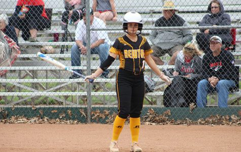 Watching softball coach Danny Park, sophomore Emily Peany is ready to go. Peaney is right handed but she is a slapper and left handed hitter for her speed. Peaney is the only member of the Railer softball team who is a slap hitter.