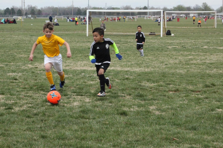 Looking toward goal, sophomore Nedic Arellano...