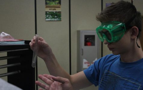 Focused sophomore James Tyrell watches the reaction of vomit lab searching for what is contained in the vomit.