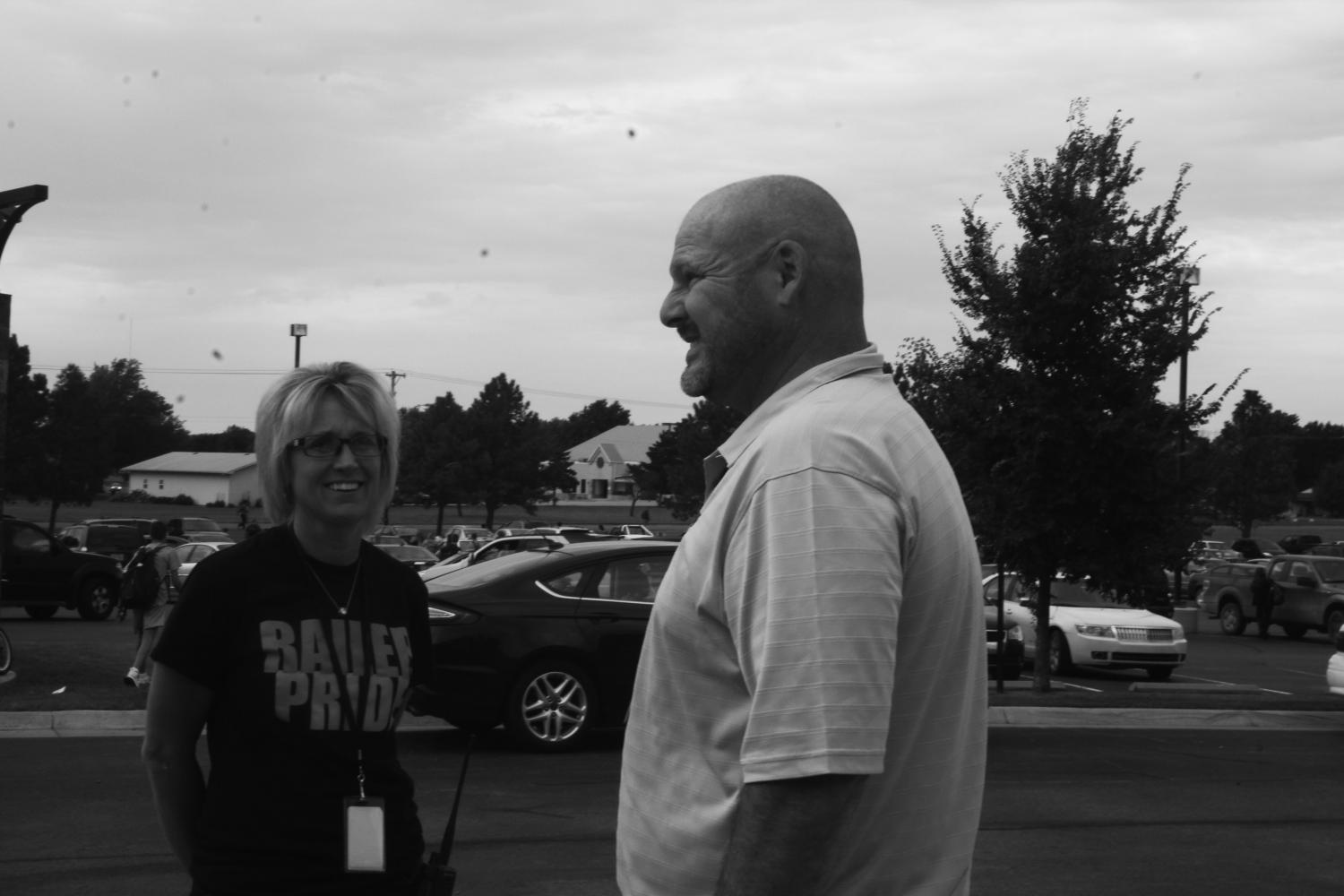 Assistant principal Jason Fawcett is having a conversation with CTE director and Railer Academy assistant principal Melinda Rangel after school on Sept. 1.  Fawcett began as assistant principal in July for the 2017-18 school year.