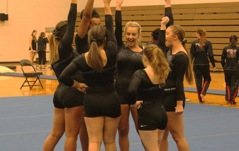 With high hopes, the gymnastics team does their chant to start the meet. The girls do this chant at the start of every meet.