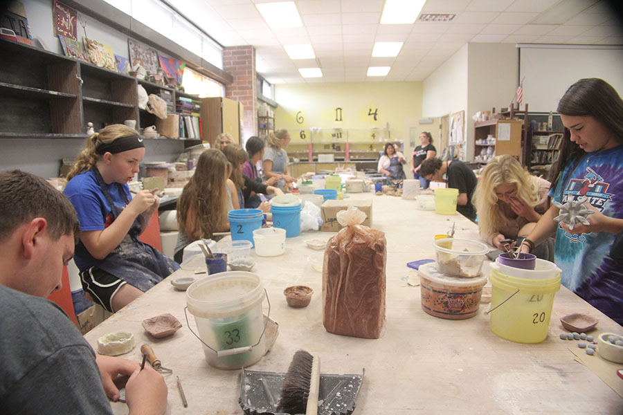 Ceramics class works on their respective projects. Mrs. Olais chimed in with advice and instructions as they worked.