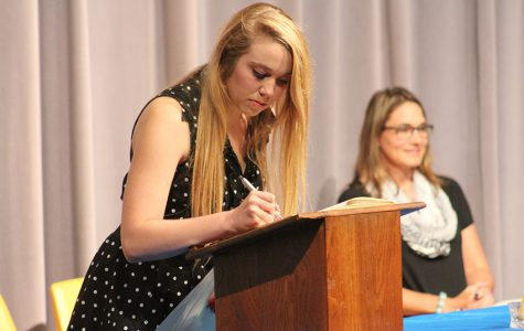 Junior Fallon Million marks her name in the NHS book, official adding herself as a member.