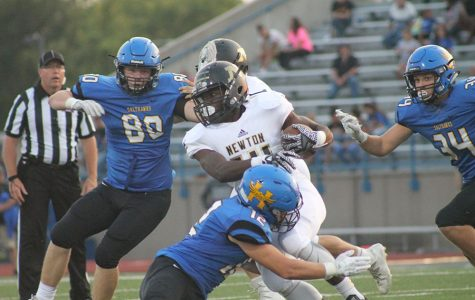 Junior, Isaiah Presley runs the ball at the football game in Hutch on September 8th.
