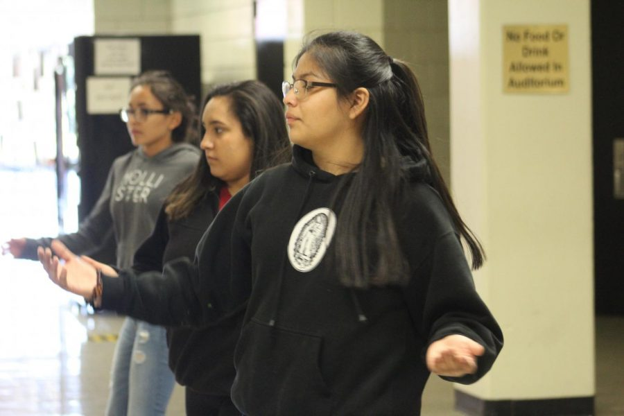 Taking the lead, freshman Jamilid Romero walks with her group taking advice from their adviser Patrice Olias. Azteca members practiced throughout the week to perform at Taste of Newton.