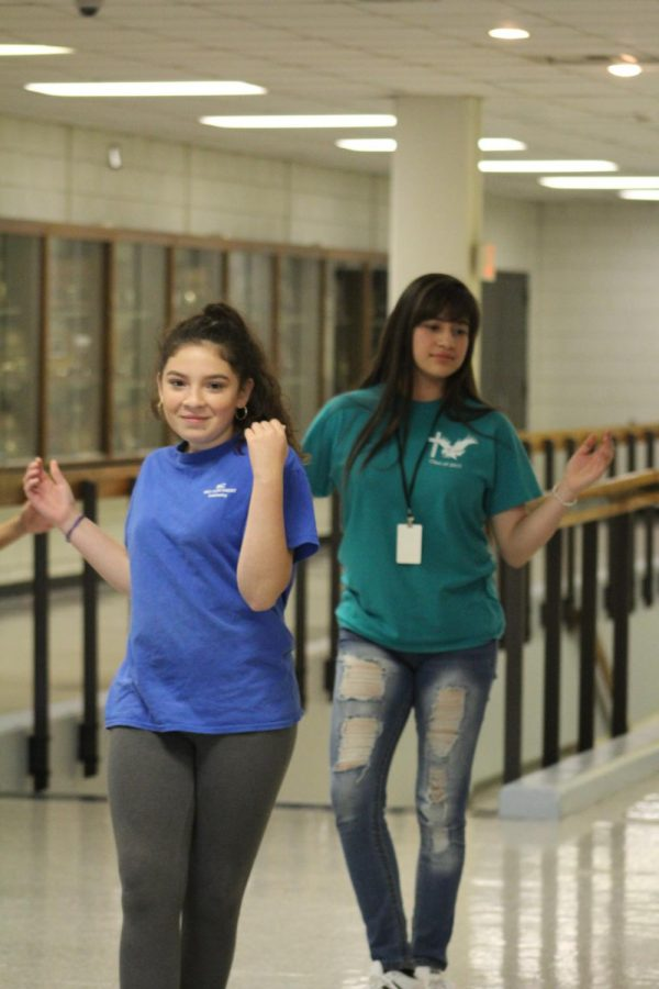 Moving to the beat sophomore Jacquelin Rigero works with her dance partner freshman Maria Romero Reyes. This year their was fourteen girls and five boys who participated in the dance.
