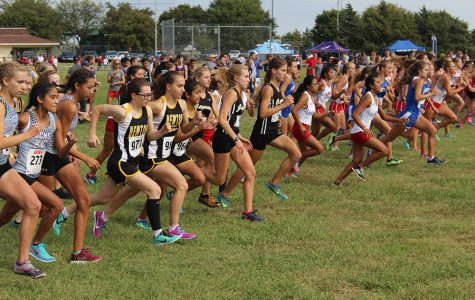 The varsity girls start to run their race for the day. This meet was held at Centennial Park in Newton.