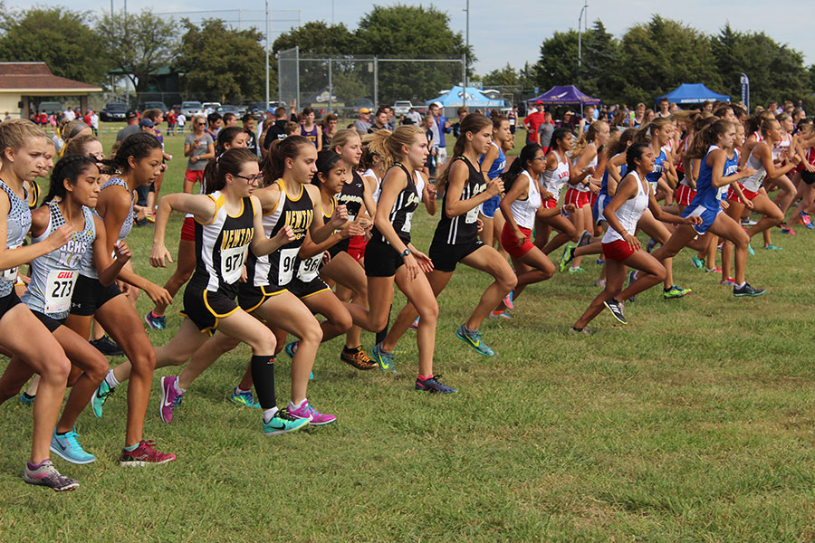 The+varsity+girls+start+to+run+their+race+for+the+day.+This+meet+was+held+at+Centennial+Park+in+Newton.