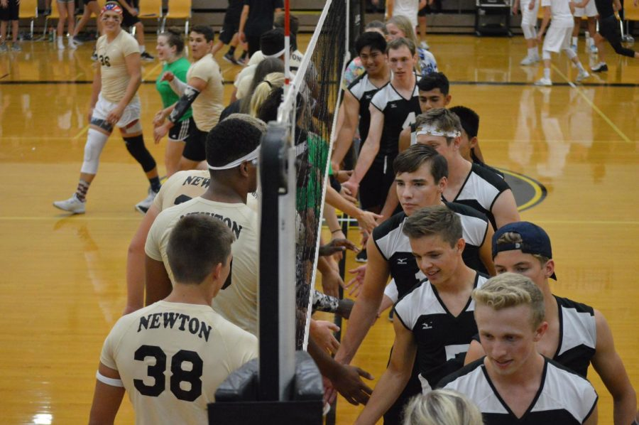 After the championship match, the senior and junior teams congratulate each other. The juniors beat the seniors in a close match.
