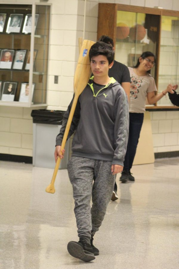 Ready to row down the hall, freshman Alex Velverda marches in step with the others performing their second big group dance. The boys participated in two huge group dances that night reviewing over all of their steps with Mrs. Olias.