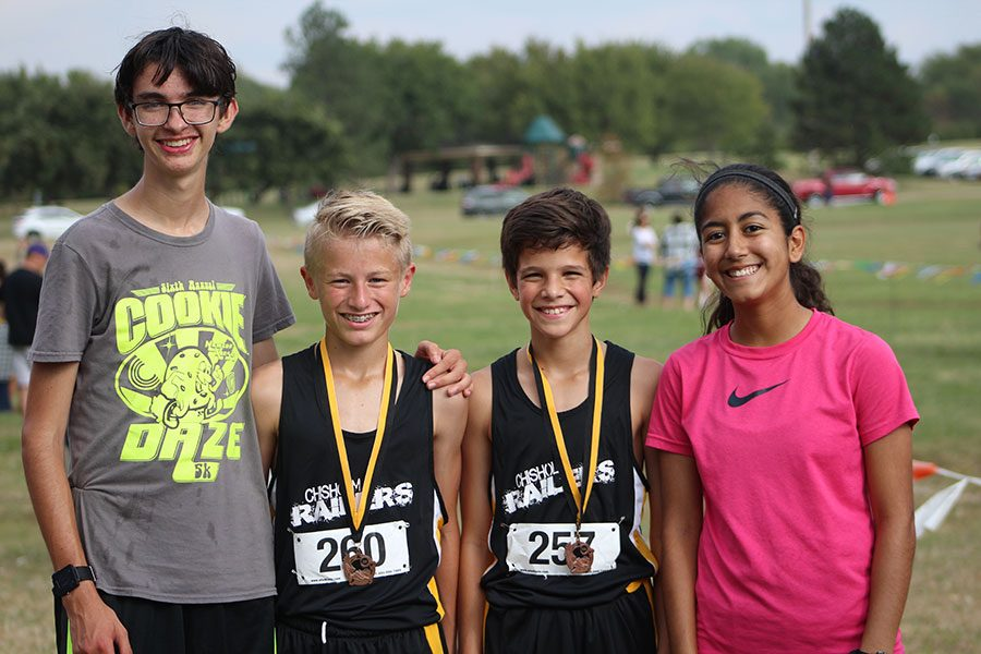 Junior+Lylia+Fernandez+congratulates+two+of+the+Newton+cross+country+participants.+The+two+boys+claimed+the+first+two+medals+from+the+7th+grade+boys+race.+