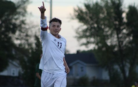 Senior Jose Rojas holds up a number one to celebrate his first goal of the game. The game took place at Fischer Field on September 21 against Salina South.
