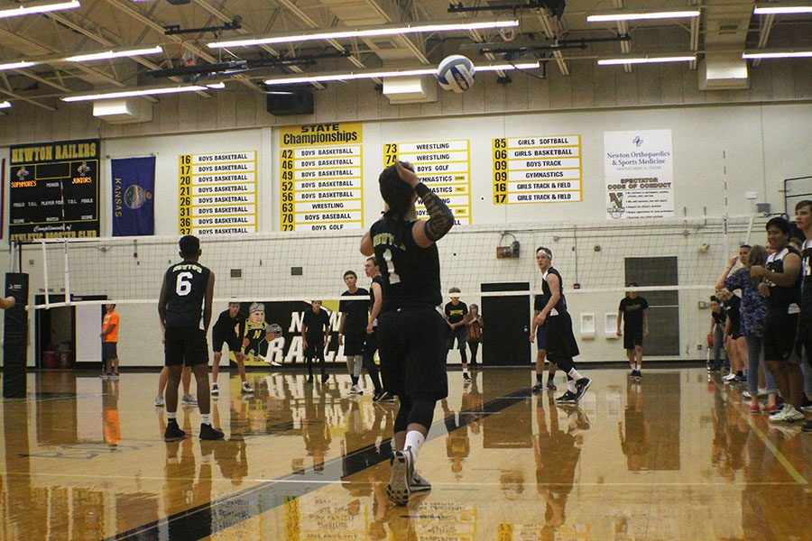 Senior Alex Kern goes to serve the ball during a match against the freshmen.