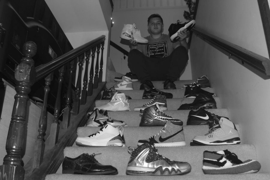 Wells displays the shoes he has personally customized.