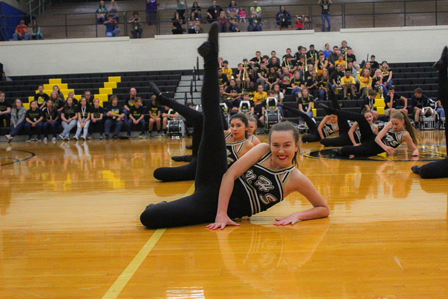 Kicking her leg up sophomore Meya Green smiles at the camera. Meya also dances outside of the schools dance team.