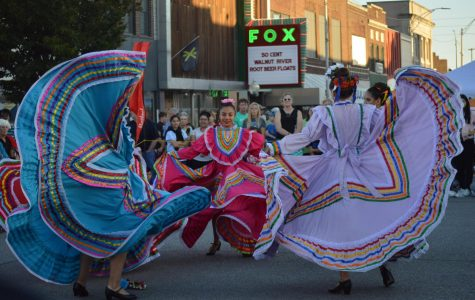 Sophomore Salma Chavez dances while the dancers beside her twirl their skirts. The dance they performed was from a region of Mexico called Jalisco.