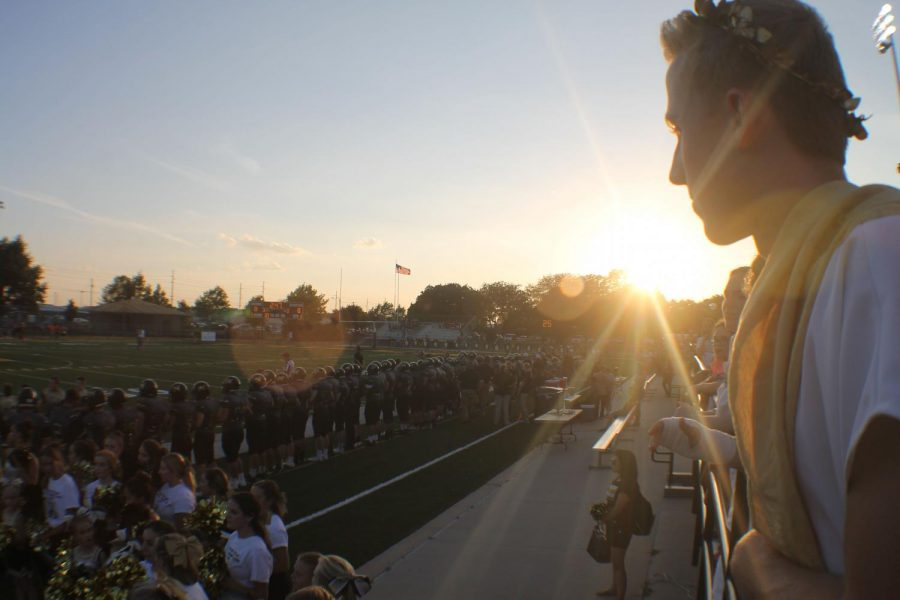 Senior Ryan Hirsh watches the game from the rail. The theme for the game was Toga Night.