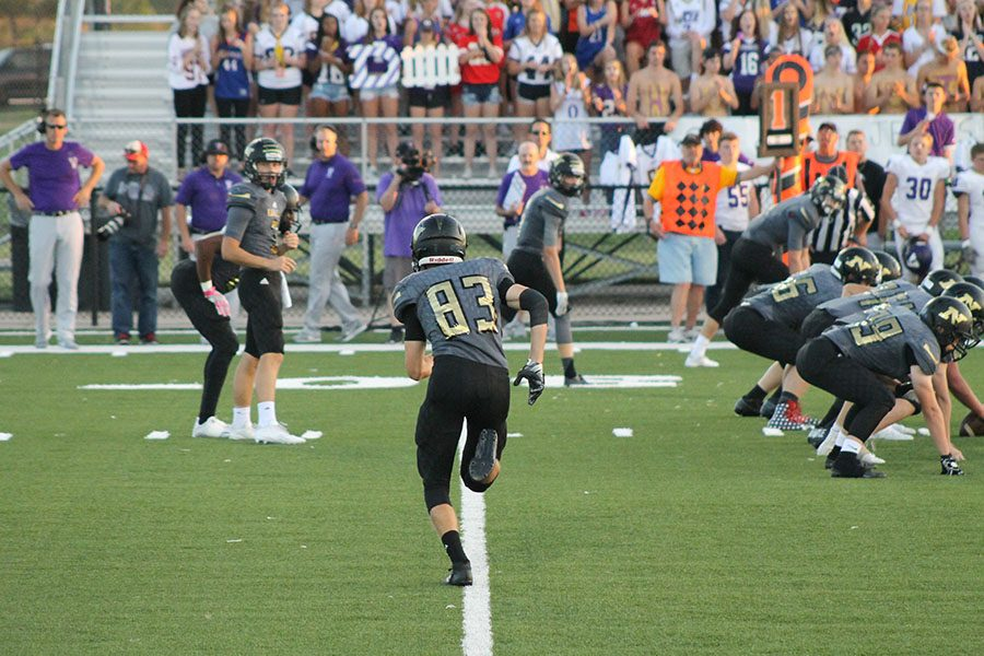 Senior Hunter Mapes runs down the line during a play.