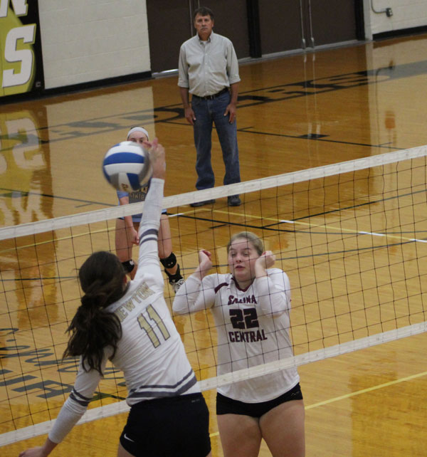 Junior Maggie Remsberg squares up for a spike against Salina Central. Newton won first place over both the Salina Central and Hutch teams.